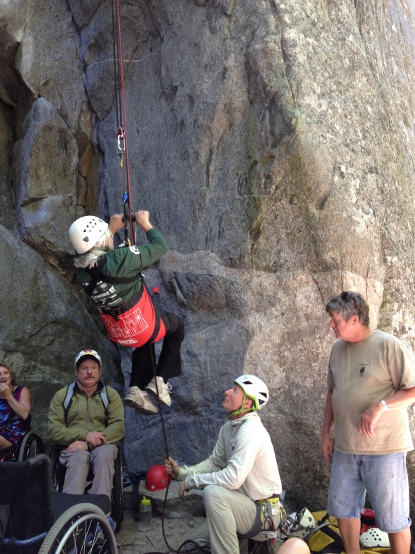 Climber Sheryl Cooley sets out under the watchful eye of Mark Wellman and a Yosemite Mountaineering School guide.