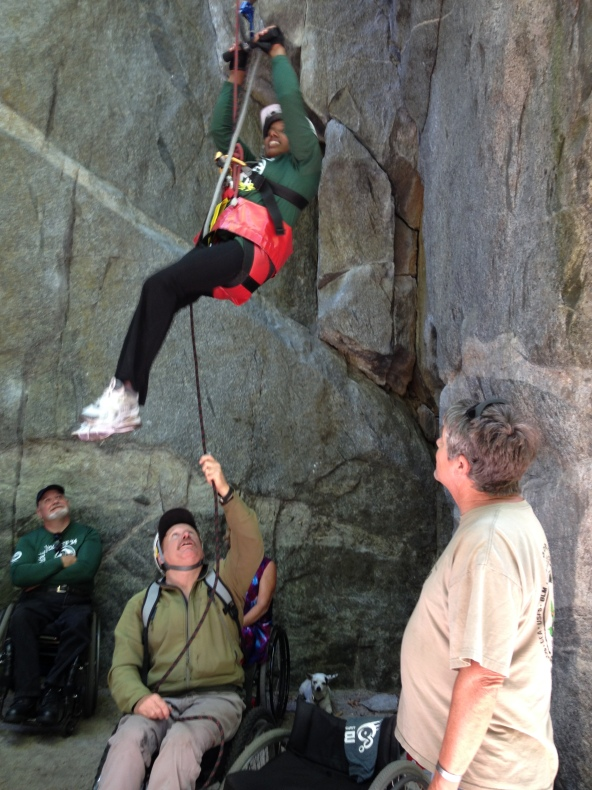 Climber Abeba Benton is strong enough that she doesn't need the 3:1 mechanical advantage, simply executing dozens of pull-ups to reach the top.