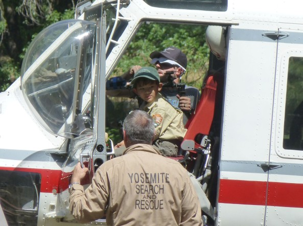 Ranger Gabriel assists with transport to the search and rescue helicopter.