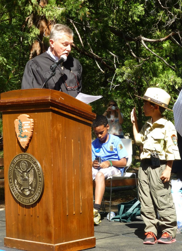 Ranger Gabriel is sworn in as an Honorary Park Ranger by Judge Michael Seng. photo by Michelle Hansen.
