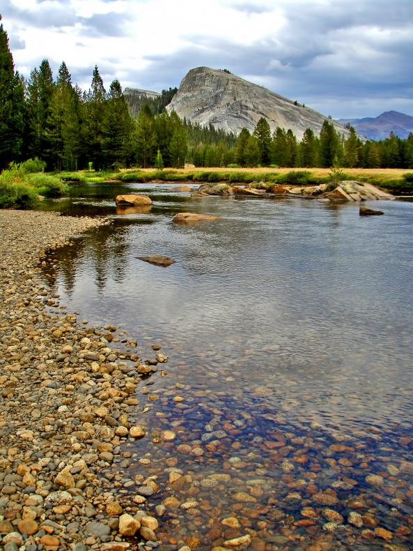 Lembert Dome rises above the Tuolumne River, flowing northwest towards Hetch Hetchy and San Francisco. Photo by Kenny Karst.